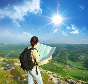 9512680-girl-tourist-in-mountain-read-the-map-map-journey